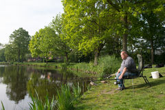 Pêcheur avec les cannes à pêche Photo libre de droits