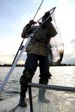Pêcheur avec un poisson contagieux Image libre de droits