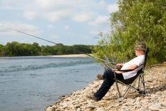 Pêcheur dans le fleuve Image stock