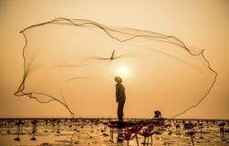 Pêcheur de lac Photographie stock