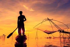 Pêcheur de silhouette Photographie stock libre de droits