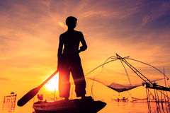 Pêcheur de silhouette Photographie stock
