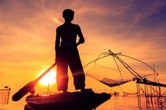 Pêcheur de silhouette Image stock