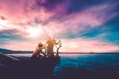 Pêcheur et fils Photo stock