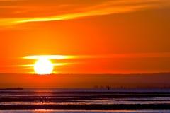 Pêcheur local dans le coucher du soleil Photographie stock