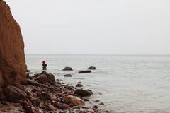 Pêcheur Stones en automne d'eau de mer Photos libres de droits