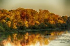 Pêcheur sur un lac Image stock