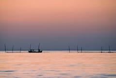 Pêcheurs au lever de soleil Images stock