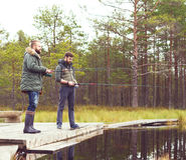 Pêcheurs avec des tiges de rotation pêchant des poissons Photographie stock libre de droits