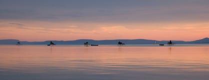 Pêcheurs de coucher du soleil Photo stock