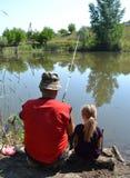 Pêcheurs première génération avec la petite-fille Photographie stock libre de droits
