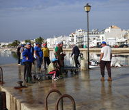 Pêcheurs sur la jetée Photo stock