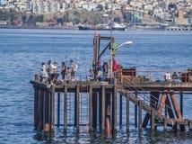 Pêcheurs sur le pilier Photo libre de droits