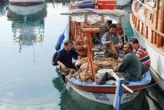 Pêcheurs turcs dans le bateau Images stock