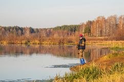 Pêcheuse avec la tige de rotation Photo libre de droits