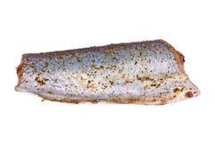 pêchez, morceau de corps de merluches bleues avec des épices D'isolement sur le fond blanc Photographie stock