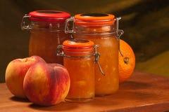 Pêssegos & doce de fruta de laranjas Imagem de Stock Royalty Free