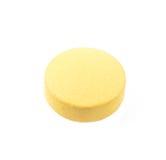 Píldora amarilla aislada en blanco Fotos de archivo