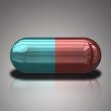 Píldora azul y roja Fotografía de archivo libre de regalías