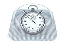 Píldora con el cronómetro Fotografía de archivo libre de regalías