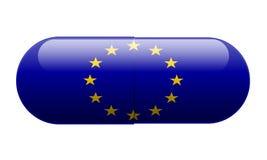 Píldora envuelta en una bandera de la UE imagen de archivo