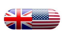 Píldora envuelta en Union Jack y banderas de los E.E.U.U. Foto de archivo libre de regalías