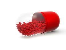 Píldora roja Imágenes de archivo libres de regalías