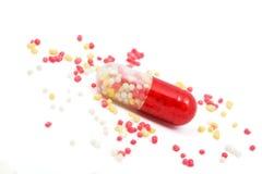 Píldora roja y blanca de la cápsula Imagenes de archivo