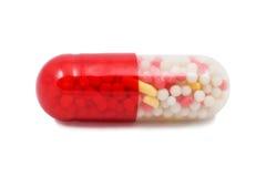 Píldora roja y blanca de la cápsula aislada Imagenes de archivo