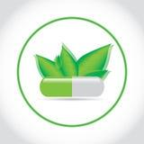 Píldora verde con las hojas Imagenes de archivo