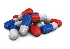 píldoras 3d en un fondo blanco Imagenes de archivo