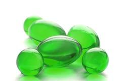 Píldoras abstractas en color verde Imagen de archivo