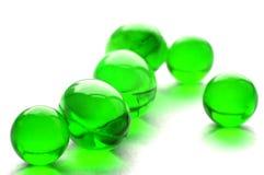 Píldoras abstractas en color verde Imágenes de archivo libres de regalías