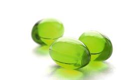 Píldoras abstractas en color verde Imagen de archivo libre de regalías