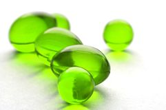 Píldoras abstractas en color verde Fotografía de archivo
