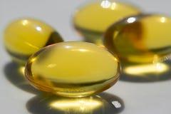 Píldoras amarillas Foto de archivo libre de regalías