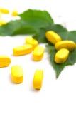 Píldoras amarillas de la vitamina Imagen de archivo libre de regalías