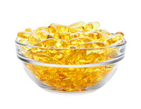Píldoras amarillas en cuenco Fotografía de archivo