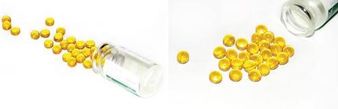 Píldoras amarillas fuera de la botella Imagen de archivo libre de regalías
