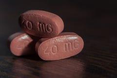 Píldoras apiladas del rojo 40mg Fotos de archivo libres de regalías