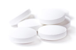 Píldoras blancas imagen de archivo