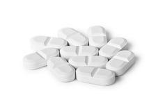 Píldoras blancas Foto de archivo libre de regalías