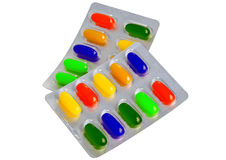 Píldoras coloreadas de las píldoras en el brillo Imagenes de archivo