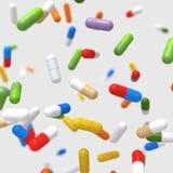 Píldoras coloridas que caen - ejemplo 3D imágenes de archivo libres de regalías