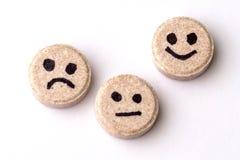 Píldoras de la alegría, de la tristeza y de la indiferencia imagen de archivo libre de regalías