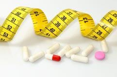 Píldoras de la dieta Fotografía de archivo libre de regalías