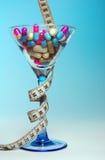 Píldoras de la dieta Imágenes de archivo libres de regalías