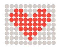 Píldoras de la dimensión de una variable del corazón Fotografía de archivo libre de regalías