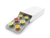 Píldoras de la vitamina Fotografía de archivo