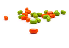 Píldoras de la vitamina cortadas Fotos de archivo libres de regalías